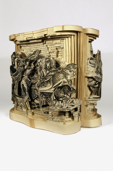 Brian Dettmer transforms books using knives, tweezers, and surgical tools.