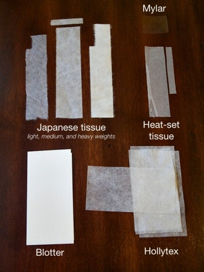 Various tissues and other materials used for paper repair.