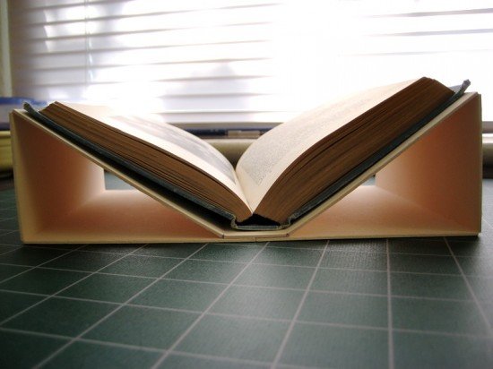 Ideally, the measurements should account for the board thickness and should therefore not be visible from overhead, but our instructions were simplified; here you can see that the cradle extends beyond the borders of the book slightly.