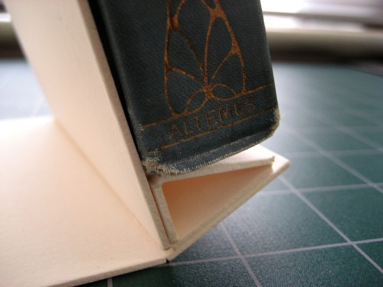 This is the same problem we ran into initially—the base support doesn't sit at a 90° angle from the board support, so it isn't flush with the base of the book. So, while the idea is pretty clear, my measurements need some tweaking.