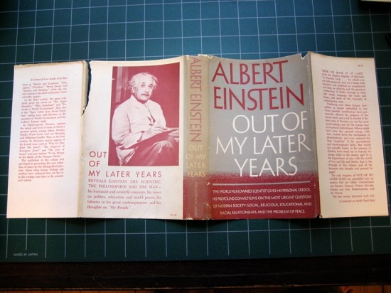 The dust jacket is torn in multiple locations and weakened in others. You can also see significant yellowing on the spine portion and other edges.
