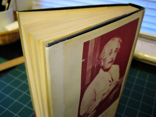 The most obvious damage to the dust jacket was the tear along this fore-edge. Because the tear was right on the crease, I ended up using Japanese tissue on both sides of the paper. It's definitely not invisible, but paste repairs are reversible, so an off-white paper could be used in the future, if desired.