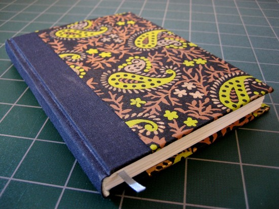 The finished book. Like the last one, I added a ribbon bookmark. The endsheets are the same light-blue color.