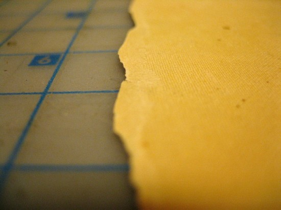 "At the edge of the paper, it's clear that the ""woven"" portion is a separate layer from the rest of the paper."