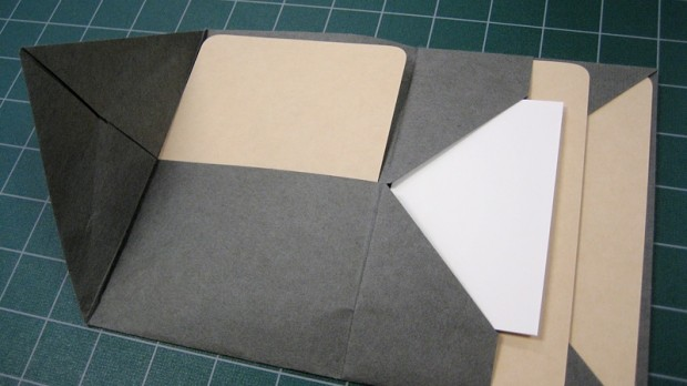 This envelope fold (not made by me) is the same as the one with the card inserts above, but it better illustrates where the potential pockets are.