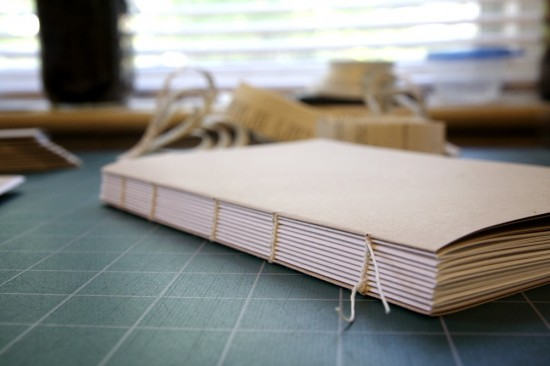 I won't post shots of the covered book until after the wedding, to maintain some element of surprise. This is my first time sewing a cased-in book without tapes. I also used fewer leaves per signature than usual (folio in sixes, instead of in eights or tens), but the resulting swell at the spine means I'm going to have to back it. It's going to be tricky, without a backing press, but I have a plan for faking it. Thanks to a tip I learned from Lisa Clark at Baker Library, I also sewed in the folio-in-fours endsheets, instead of tipping on a single folio. It's a nice touch.